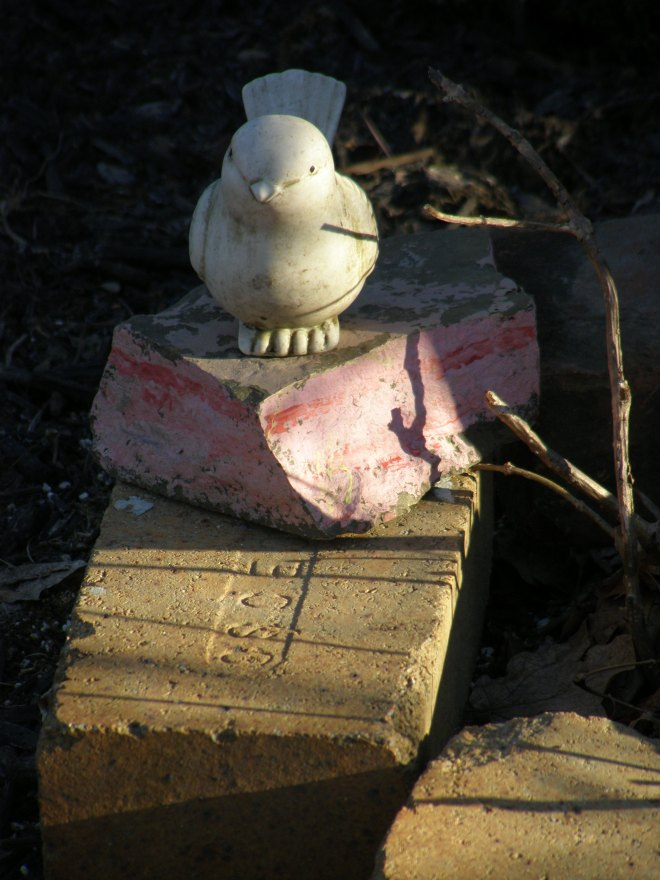 ceramic birdies painted rocks old bricks...my winter garden garb when the flowers are sleeping