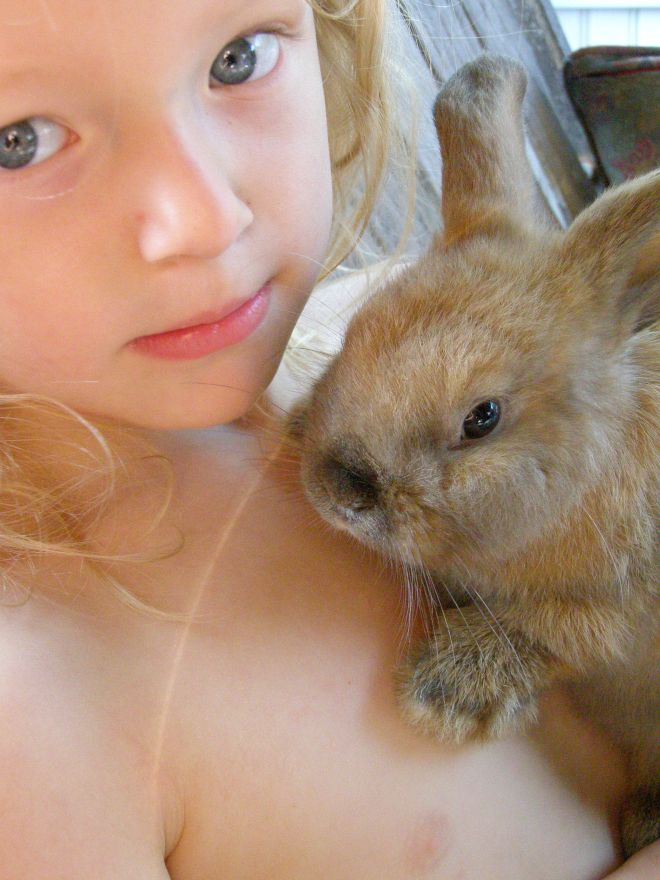 a girl with her bunny